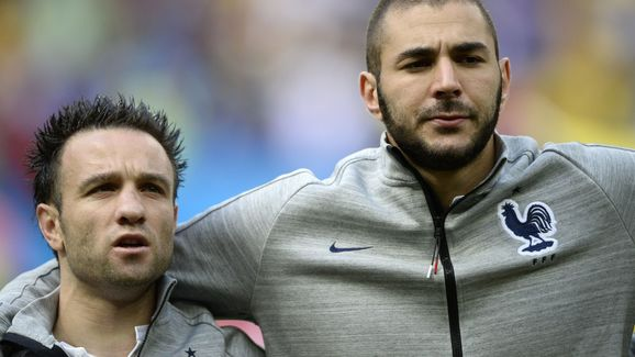 France's midfielder Mathieu Valbuena (L) and forward Karim Benzema listen to their national anthem before the round of 16 football match between France and Nigeria at the Mane Garrincha National Stadium in Brasilia during the 2014 FIFA World Cup on June 30, 2014. AFP PHOTO / FRANCK FIFE (Photo credit should read FRANCK FIFE/AFP/Getty Images)