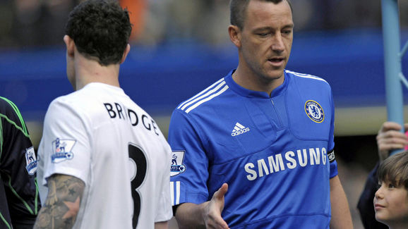 Chelsea's captain John Terry (R) fails to get a hand shake from Manchester City's English defender Wayne Bridge (L) before the English Premier League football match between Chelsea and Manchester City at Stamford Bridge in London, England on February 27, 2010. AFP PHOTO/OLLY GREENWOOD FOR EDITORIAL USE ONLY Additional licence required for any commercial/promotional use or use on TV or internet (except identical online version of newspaper) of Premier League/Football League photos. Tel DataCo +44 207 2981656. Do not alter/modify photo. (Photo credit should read OLLY GREENWOOD/AFP/Getty Images)